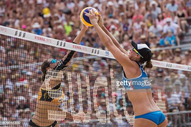 Lauren Fendrick of the United States blocks the ball during the gold medal match against Laura Ludwig and Kira Walkenhorst of Germany at FIVB Beach...