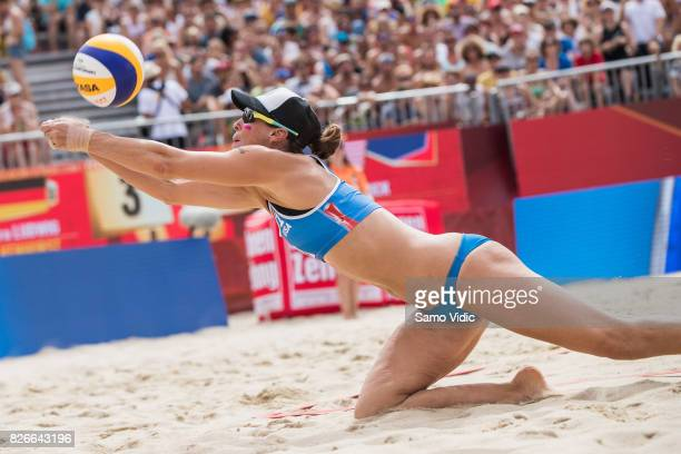 Lauren Fendrick of the United States receives the ball during the gold medal match against Laura Ludwig and Kira Walkenhorst of Germany at FIVB Beach...