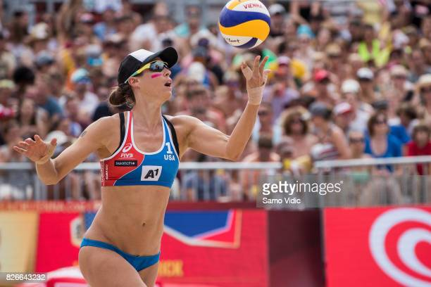 Lauren Fendrick of the United States serves the ball during the gold medal match against Laura Ludwig and Kira Walkenhorst of Germany at FIVB Beach...