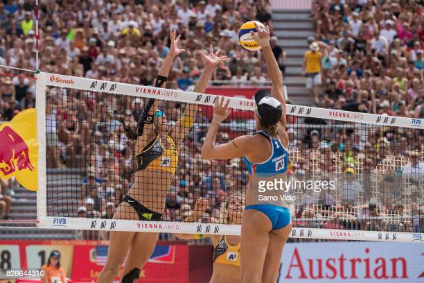 Lauren Fendrick of the United States spikes the ball during the gold medal match against Laura Ludwig and Kira Walkenhorst of Germany at FIVB Beach...