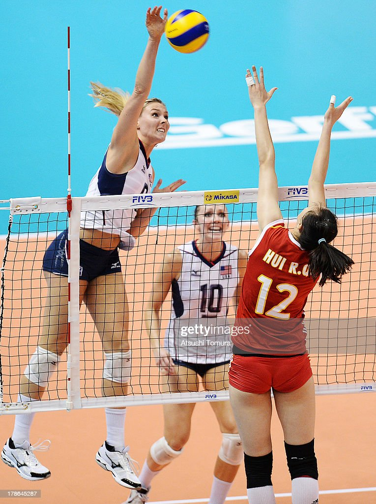 Lauren Gibbemeyer of USA spikes the ball during day three of the FIVB World Grand Prix Sapporo 2013 match between China and USA at Hokkaido Prefectural Sports Center on August 30, 2013 in Sapporo, Hokkaido, Japan.