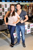 Lauren Goodger and Mark Wright attend the signing of The Only Way Is Essex DVD at HMV lakeside on March 28 2011 in London England