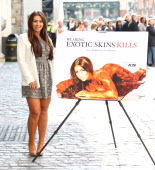 Lauren Goodger unveils new AntiExoticSkins PETA ad at Covent Garden on April 3 2012 in London England