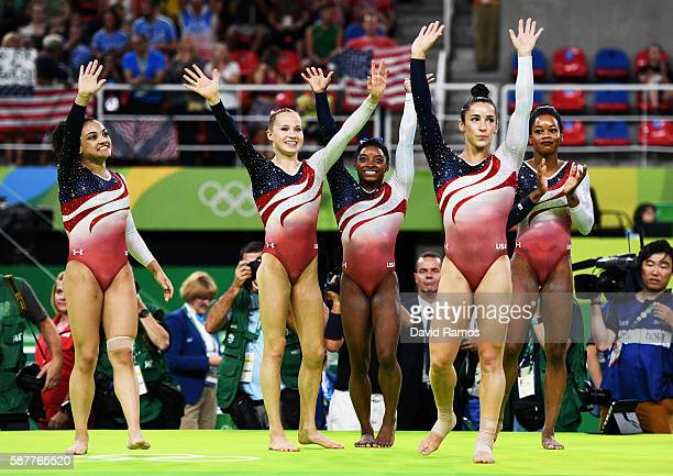 Lauren Hernandez Madison Kocian Simone Biles Alexandra Raisman and Gabrielle Douglas of the United States celebrate winning the gold medal during the...