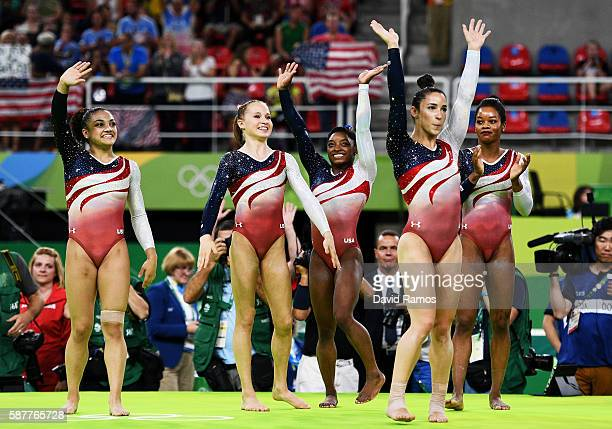 Lauren Hernandez Madison Kocian Simone Biles Alexandra Raisman and Gabrielle Douglas of the United States wave to fans to celebrate winning the gold...