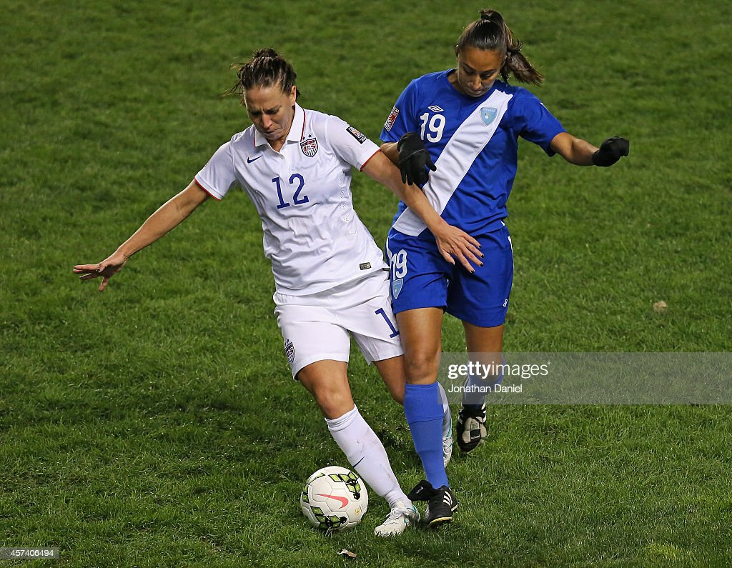 Lauren Holiday #12 of the United States holds off Diana Berrera #19 of Guatemala during the 2014 CONCACAF Women's Championship at Toyota Park on October 17, 2014 in Bridgeview, Illinois. The United States defeated Guatemala 5-0.