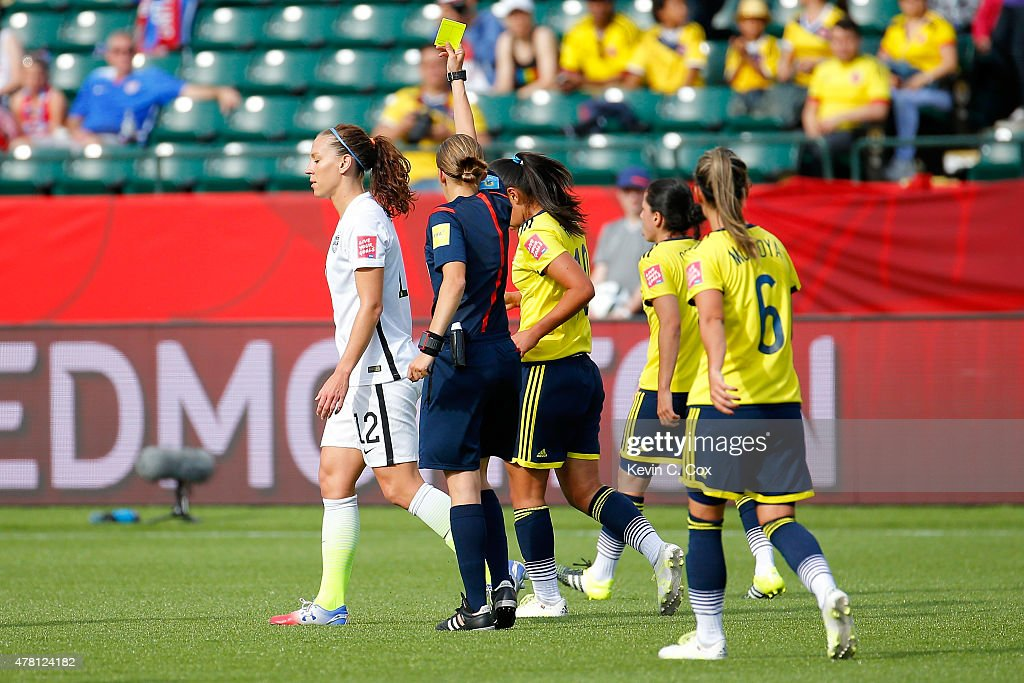 Lauren Holiday of the United States is given a yellow card in the first half against Colombia in the FIFA Women's World Cup 2015 Round of 16 match at...