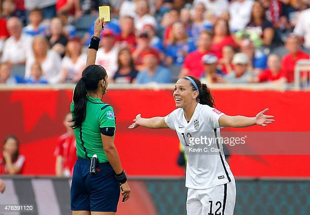 Lauren Holiday of United States receives a yellow card in the second half against Australia during the FIFA Women's World Cup 2015 Group D match at...