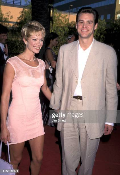 Lauren Holly and Jim Carrey during 'The Nutty Professor' Los Angeles Benefit Premiere at Universal Studios Amphiteatre in Universal City California...