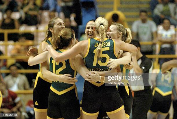 Lauren Jackson and Belinda Snell of Australia celebrate their victory with their teammates during a game between Brazil and Australia during the 2006...