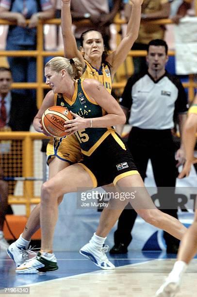Lauren Jackson of Australia drives to the basket past Ega Soeli Zakrzeski of Brazil during a game between Brazil and Australia during the 2006 FIBA...