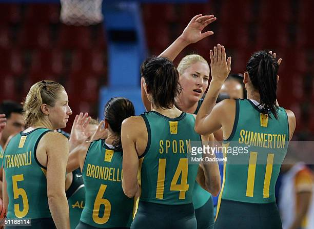 Lauren Jackson of Australia is congratulated by teammates after defeating Nigeria in the women's basketball preliminary game on August 14 2004 during...