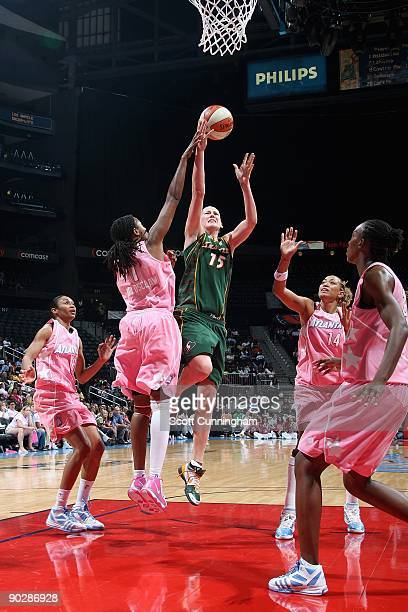 Lauren Jackson of the Seattle Storm lays the ball up against Chamique Holdsclaw of the Atlanta Dream during the WNBA game on August 15 2009 at...