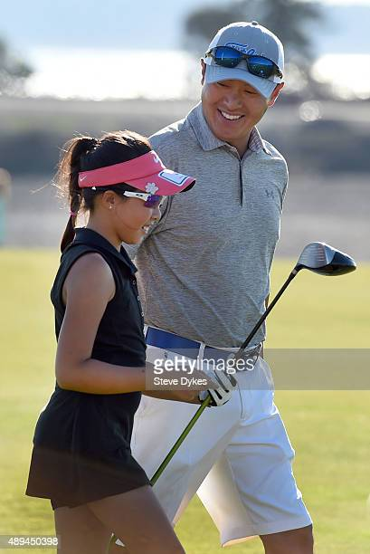 Lauren Kim smiles as she walks away from the Drive competition in the Girls 1011 yr old division of the Drive Chip and Putt regional qualifying at...