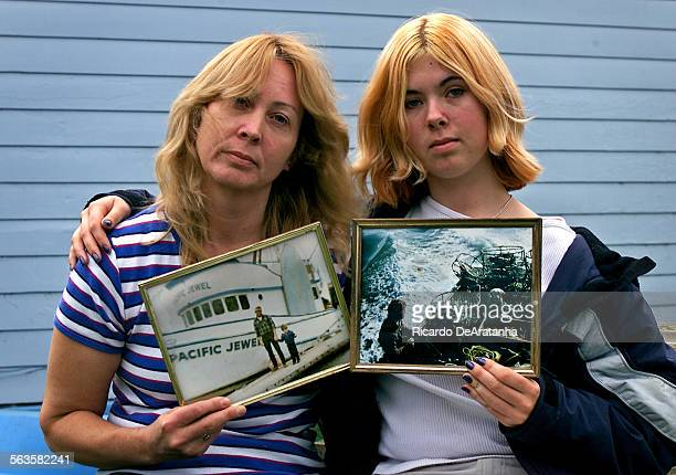 Lauren Kirkpatrick left and daughter Julia Meddock holding pictures of family members lost at sea in the small fishing town of Trinidad on the...