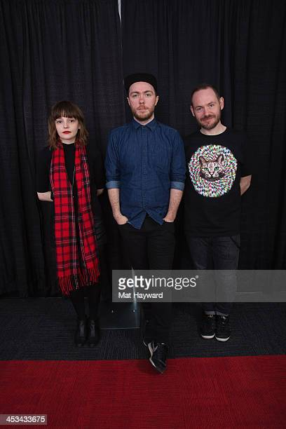 Lauren Mayberry Martin Doherty and Iain Cook of Chvrches pose for a portrait backstage during the Deck the Hall Ball hosted by 1077 The End at Key...