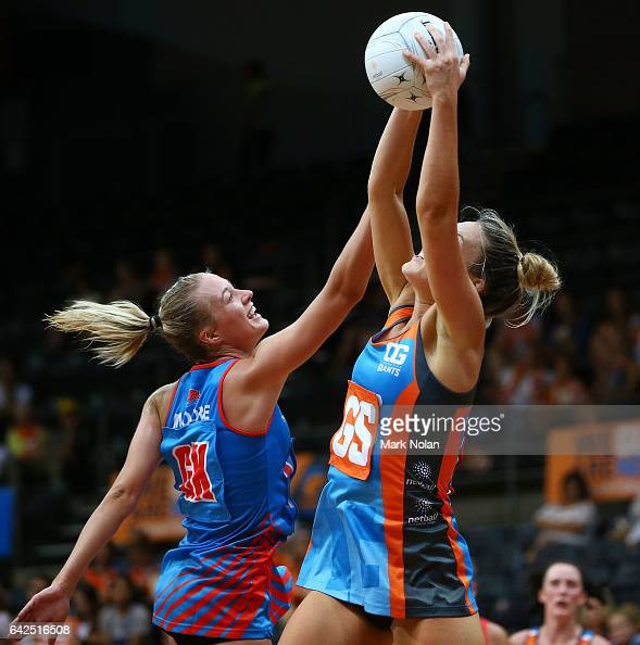 Lauren Moore of NSW and Keira Austin of Canberra contest possession during round one of the ANL match between Canberra Giants and Netball NSW...
