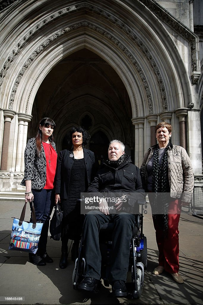 Lauren Nicklinson, Saimo Chahal, Paul Lamb and Jane Nicklinson pose for a photograph outside the Royal Courts of Justice on the first day in a three day hearing on legalising the right to die with the aid of a doctor on May 13, 2013 in London, England. Mr Lamb, who is paralysed from the neck down, is continuing the legal battle started by the late Tony Nicklinson, who suffered from locked in syndrome.