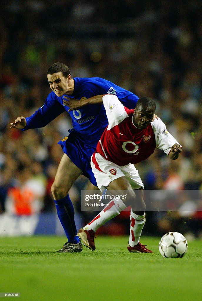 Lauren of Arsenal holds off John O'Shea of Manchester United during the FA Barclaycard Premiership match between Arsenal and Manchester United held on April 16, 2003 at Highbury in London, England. The match ended in a 2-2 draw.