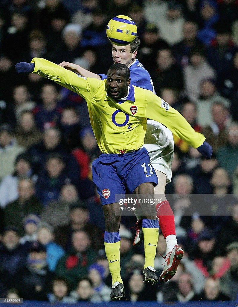 Lauren of Arsenal makes a challenge in the air with Matthew Taylor of Portsmouth during the Barclays Premiership match between Portsmouth and Arsenal at Fratton Park on December 19, 2004 in London, England.