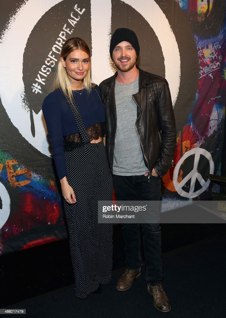 Lauren Parsekian and Aaron Paul attend the ESPN The Party at Basketball City Pier 36 South Street on January 31st 2014 in New York City