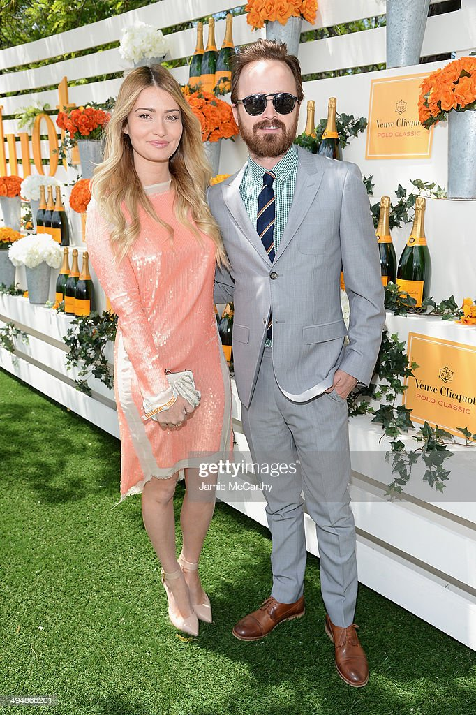 Lauren Parsekian and Aaron Paul attend the seventh annual Veuve Clicquot Polo Classic in Liberty State Park on May 31, 2014 in Jersey City City.