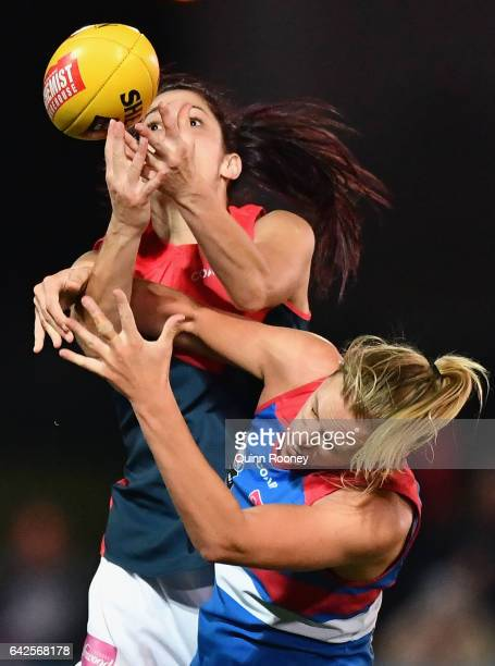 Lauren Pearce of the Demons marks over the top of Lauren Spark of the Bulldogs during the Women's round three match between the Western Bulldogs and...