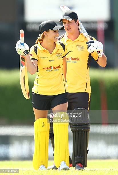 Lauren Phillips celebrates with Johnny Ruffo as they bat during the Medibank Melbourne Celebrity Twenty20 match at North Port Oval on February 21...