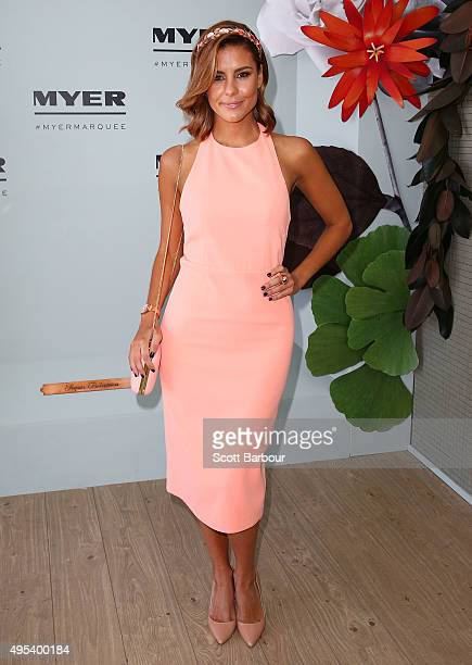 Lauren Phillips wearing Asilio and millinery by Eugenia Kim poses at the Myer Marquee on Melbourne Cup Day at Flemington Racecourse on November 3...
