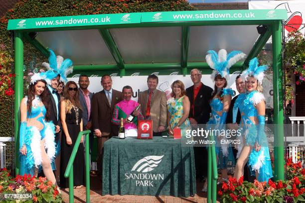 Lauren Pope and Michael Underwood present the awards after The De Vere Venues Atalanta Stakes to jockey Davy Bonilla and trainer Brian Meehan