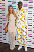 Lauren Pope and Vas Morgan attends the Attitude Magazine Hot 100 party at Paramount Club on July 16 2014 in London England