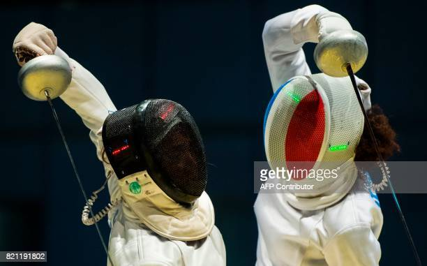 Lauren Rembi of France fights against Sarra Besbes of Tunisia during a qualification duel of the Individial Women's Epee competition at the World...