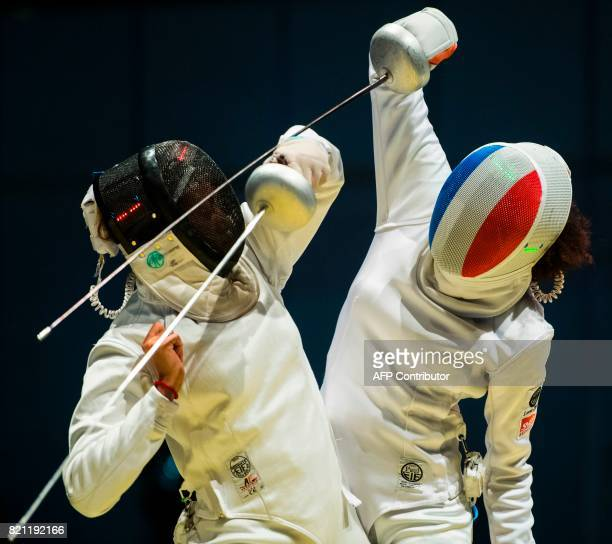 Lauren Rembi of France fights against Sarra Besbes of Tunisia during a qualification duel of the Individable Women's Epee competition at the World...