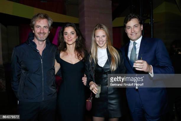 Lauren Ricard her husband Gregoire Scholler owner of 'Beaux Arts magazine' Frederic Jousset and his wife Teodora attend the 'Bal Jaune Elastique...
