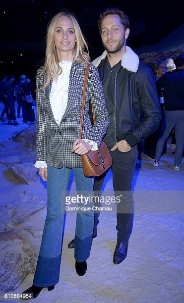 Lauren Santo Domingo and Derek Blasberg attend the Moncler Gamme Rouge show as part of the Paris Fashion Week Womenswear Spring/Summer 2017 on...