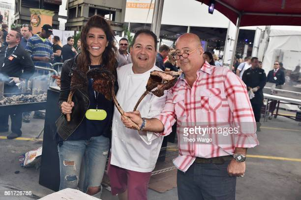 Lauren Scala chef Josh Capon and host Andrew Zimmern attend the Food Network Cooking Channel New York City Wine Food Festival Presented By CocaCola...