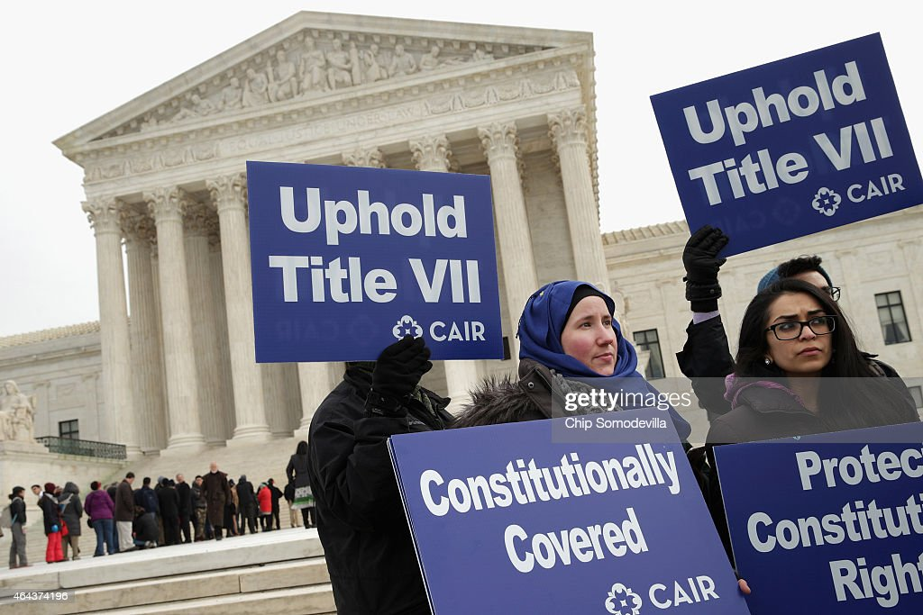 Lauren Schreiber (L) and Umna Khan join other supporters from The Council on American-Islamic Relations during a news conference outside the U.S. Supreme Court after the court heard oral arguments in EEOC v. Abercrombie & Fitch February 25, 2015 in Washington, DC. Samantha Elauf of Tulsa, Oklahoma, filed a charge of religious discrimination with the Equal Employment Opportunity Commission saying Abercrombie & Fitch violated discrimination laws in 2008 by declining to hire her because she wore a head scarf, a symbol of her Muslim faith.