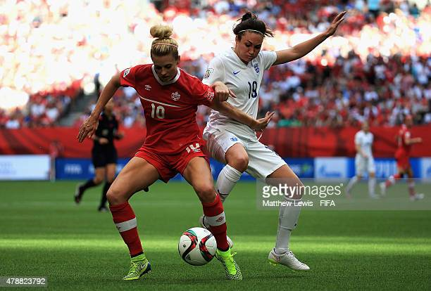 Lauren Sesselmann of Canada and Jodie Taylor of England challenge for the ball during the FIFA Women's World Cup 2015 Quarter Final match between...