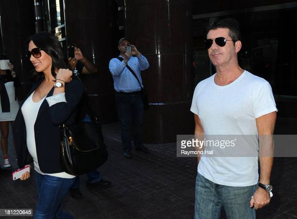 Lauren Silverman and Simon Cowell are seen in Soho on September 19 2013 in New York City