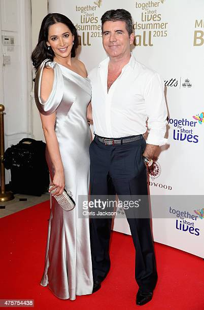 Lauren Silverman and Simon Cowell arrive for the Together for Short Lives Midsummer Ball at Banqueting House on June 3 2015 in London England