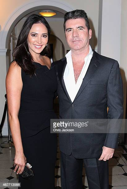 Lauren Silverman and Simon Cowell attend the British Asian Trust dinner at Banqueting House on February 3 2015 in London England