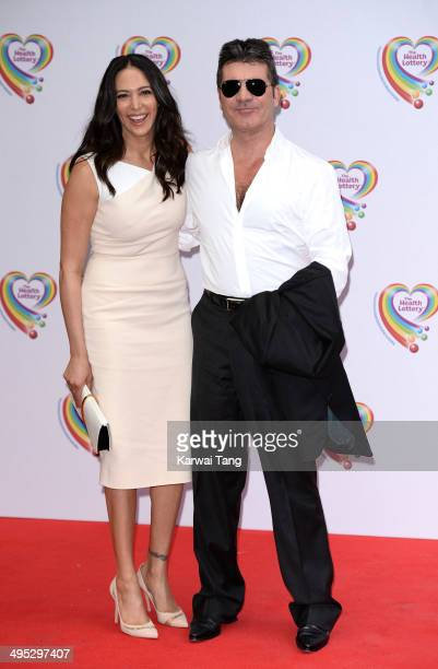 Lauren Silverman and Simon Cowell attend the Health Lottery tea party at the Savoy Hotel on June 2 2014 in London England
