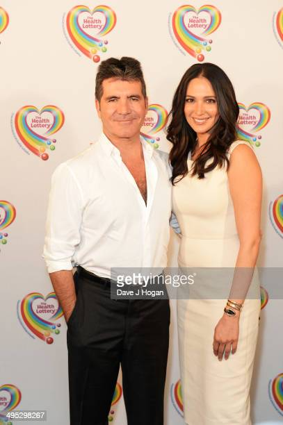 Lauren Silverman and Simon Cowell attend the Health Lottery Tea Party at The Savoy on June 2 2014 in London England