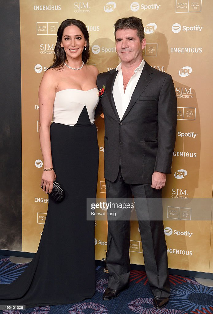 Lauren Silverman and Simon Cowell attend the Music Industry Trusts Awards in aid of the Nordoff Robbins charity and BRIT Trust at The Grosvenor House Hotel on November 2, 2015 in London, England.