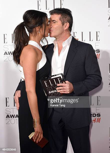 Lauren Silverman and Simon Cowell with his Outstanding Contribution to Entertainment award during the Elle Style Awards 2015 at Sky Garden @ The...