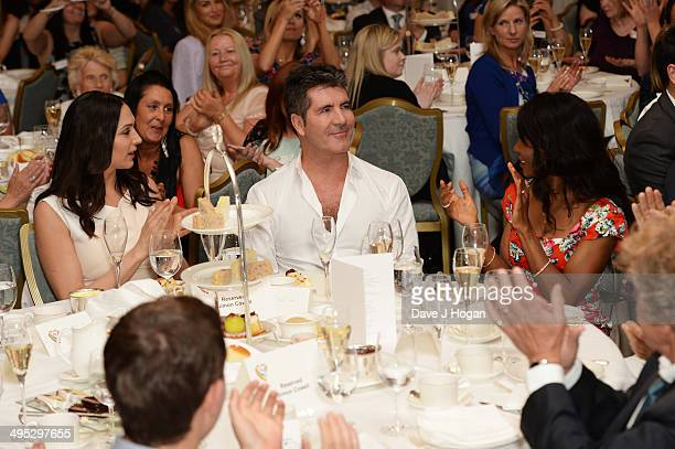 Lauren Silverman Simon Cowell and Sinitta attend the Health Lottery Tea Party at The Savoy on June 2 2014 in London England