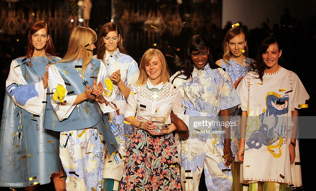 Lauren Smith from Edinburgh College of Art collects her Geroge Gold Award on the catwalk with models wearing her collection at the gala awards show for Graduate Fashion Week 2013 at Earls Court 2 on June 5, 2013 in London, England.
