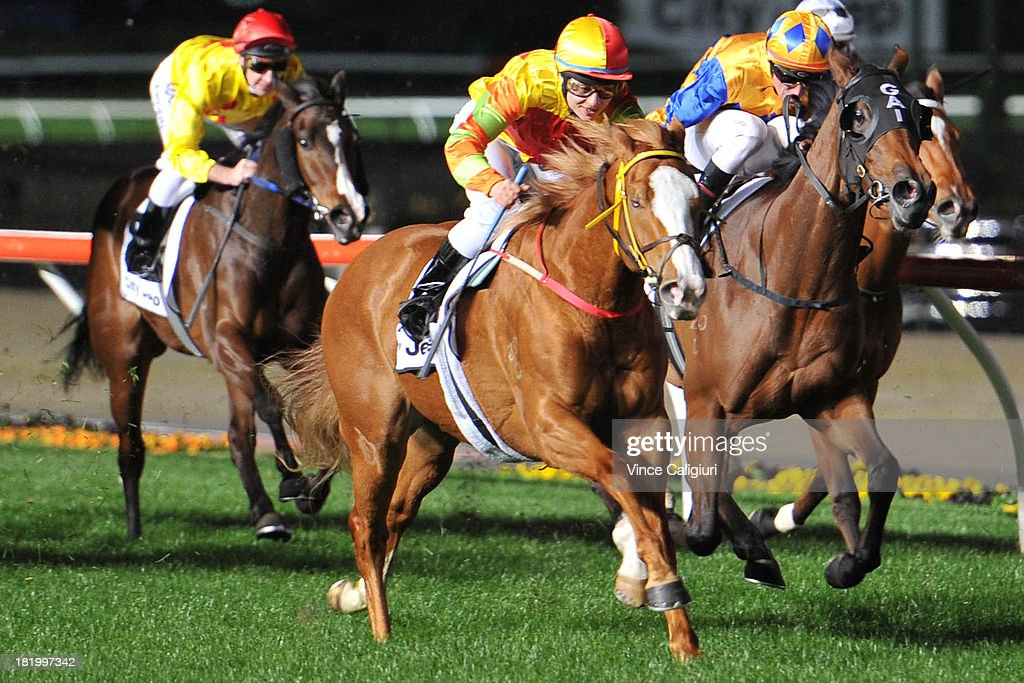 Lauren Stojakovic riding Miracles of Life (L) finishing 2nd in the Gallagher Bassett/TBV Champagne Stakes during Moonee Valley Racing at Moonee Valley Racecourse on September 27, 2013 in Melbourne, Australia.