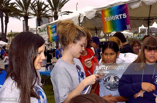 Lauren Storm signs autographs during 19th Annual Champions Run For Life at Long Beach Aquarium Esplanade in Long Beach California United States