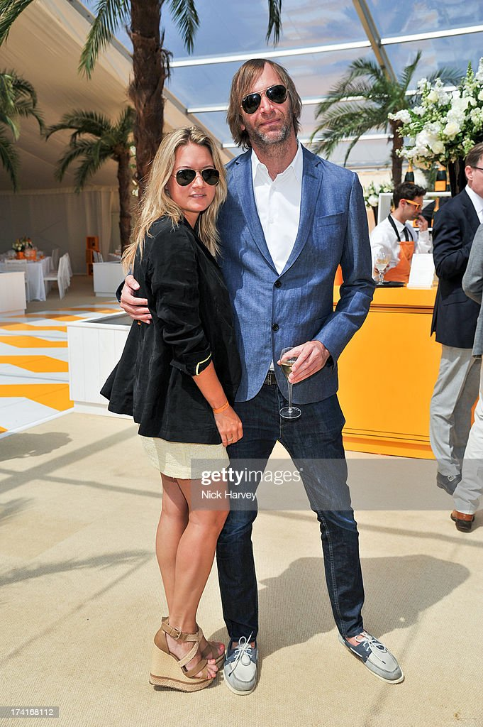 Lauren Stott and Paul Harris attend the Veuve Clicquot Gold Cup final at Cowdray Park Polo Club on July 21, 2013 in Midhurst, England.